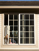 Olivia Cothren, who is immunocompromised, peers out of a window of her home as the Covid-19 pandemic takes hold across the country in Julietta, Idaho on Saturday, March 21, 2020.