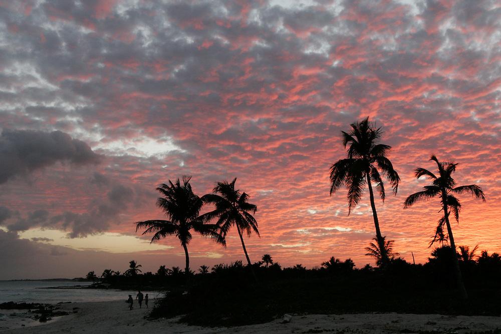 The sun sets in Tulum, Riviera Maya, Mexico.