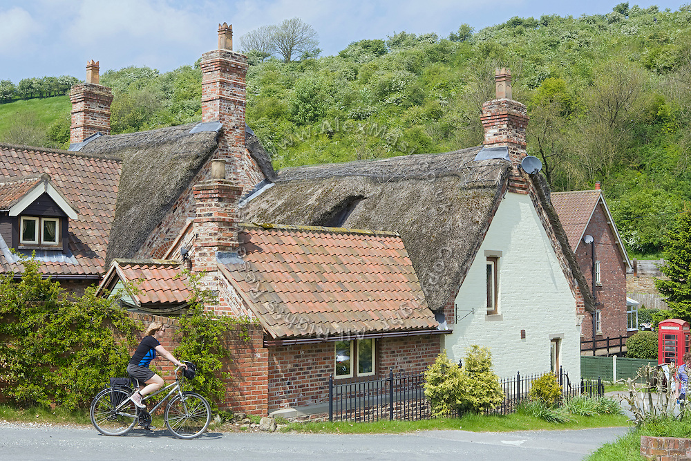 A tourist is starting to cycle from Thixendale to York, in Yorkshire, England, United Kingdom.