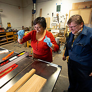 Peggy Stormoen, right, helps Gauri Bansal learn to use a table saw at The Bodgery in Madison, Wisconsin. The Bodgery is a makers space in Madison where people can use communal equipment to help create crafts in wood, metal, glass, textiles and learn from other makers. Nathan Lambrecht/Journal Communications