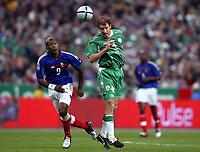 Fotball<br /> VM-kvalifisering<br /> Frankrike v Irland<br /> 9. oktober 2004<br /> Foto: Digitalsport<br /> NORWAY ONLY<br /> KENNY CUNNINGHAM (IRE) / DJIBRIL CISSE (FRA)