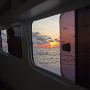 Sunset after a long day of highs and lows. Traveling to Kandui, Mentawais Islands, Indonesia March  19, 2013.
