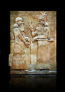 Stone relief sculptured panel of Saron II and a dignitary. Facade L. Inv AO 19873-4 from Dur Sharrukin the palace of Assyrian king Sargon II at Khorsabad, 713-706 BC.  Louvre Museum Room 4 , Paris .<br /> <br /> If you prefer to buy from our ALAMY PHOTO LIBRARY  Collection visit : https://www.alamy.com/portfolio/paul-williams-funkystock/ancient-assyria-antiquities.html  Refine search by adding background colour, place, subject, museum etc into the LOWER SEARCH WITHIN GALLERY box to <br /> <br /> Visit our ANCIENT ASSYRIAN PHOTO COLLECTIONS for more photos to download or buy as wall art prints https://funkystock.photoshelter.com/gallery-collection/Ancient-Assyrian-Art-Artefacts-Antiquities-Historic-Sites-Pictures-Images-of/C0000cjRqQyJjLag
