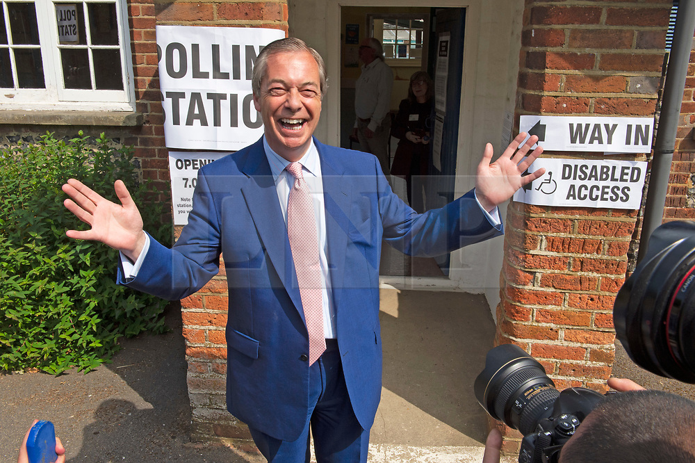 © Licensed to London News Pictures. 23/05/2019.<br /> Downe,UK. Mr Farage coming out of the polling station. Brexit Party leader Nigel Farage voting in the European elections at Cudham C of E primary school, Downe, Kent. Photo credit: Grant Falvey/LNP