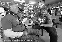 """Team Vino"" - Dean Bordigioni (Dino) left with Robert Gustavsson (Big Swede) at a gas stop during Stage 15 (244 miles) of the Motorcycle Cannonball Cross-Country Endurance Run, which on this day ran from Lewiston, Idaho to Yakima, WA, USA. Saturday, September 20, 2014.  Photography ©2014 Michael Lichter."