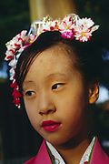 Young girl in traditional dress with flowers in her hair at the Meiji Jinja Shrine, Tokyo