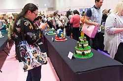 © Licensed to London News Pictures. 07/10/2016. Visitors view competition cakes at The Cake & Bake Show. London, UK. Photo credit: Ray Tang/LNP