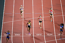 London, August 10 2017 . Kori Carter, USA, wins the women's 400m hurdles final with compatriot Dalilah Muhammad, USA, claiming sliver ahead of bronze winner  Ristananna Tracey of Jamaica on day seven of the IAAF London 2017 world Championships at the London Stadium. © Paul Davey.