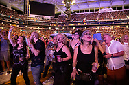 Rolling Stones fans dance as the band performs at the Hard Rock Stadium in Miami Gardens on Friday, August 30, 2019