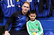 AFC Wimbledon midfielder Mitchell (Mitch) Pinnock (11) and Mascot during the EFL Sky Bet League 1 match between AFC Wimbledon and Barnsley at the Cherry Red Records Stadium, Kingston, England on 19 January 2019.