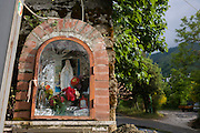 Religious edicola (aedicula votiva) shrine dedicated to the Madonna, Naples, Somma-Vesuviana, on the slopes of Vesuvius volcano, Italy.