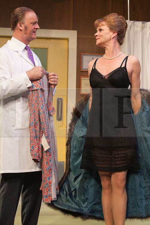 © Licensed to London News Pictures. 09/05/2012. London, England. Tim McInnerny as Dr. Prentice and Samantha Bond as Mrs Prentice. What the Butler Saw by Joe Orton and directed by Sean Foley opens at the Vaudeville Theatre, London. Photo credit: Bettina Strenske/LNP