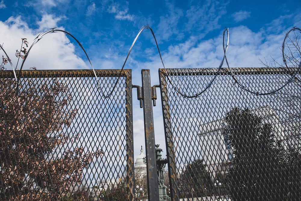 Washington DC, USA - January 18, 2021: Razor wire tops a temporary fence around the U.S. Capitol Building in Washington DC two days before Joseph Biden's inauguration
