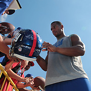 Victor Cruz signing autographs with fans after training during the 2013 New York Giants Training Camp at the Quest Diagnostics Training Centre, East Rutherford, New Jersey, USA. 29th July 2013. Photo Tim Clayton. .