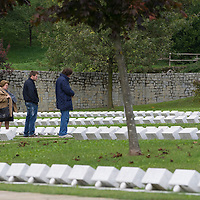 LONGARONE, ITALY - OCTOBER 09: Relatives of the victims pray inside the Cemetery of the Vajont  on October 9, 2013 in Longarone, Italy. Today is the 50th anniversary of the Vajont disaster, which occurred on 9th October 1963, and is the worst landslide disaster in European history with 2000 people killed.  (Photo by Marco Secchi/Getty Images)