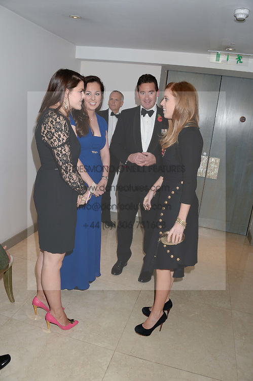 Left to right, LOTTIE ?, BECKY ?, PRINCESS BEATRICE OF YORK and COL.DAN HUGHES at Fashion For The Brave at The Dorchester, Park Lane, London on 8th November 2013.