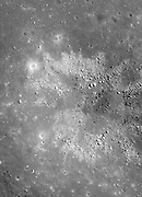 This crater occurs in Balmer Basin, an area thought to harbor a type of 'cryptomare' -- an old volcanic surface covered by later light-toned impact deposits.