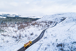 © Licensed to London News Pictures. 1/02/2019. Devils Bridge, UK. A gritter lorry heads out along the road through the hills and mountains near Devils' Bridge in Ceredigion , mid Wales, under a banket of snow Photo credit: Keith Morris/LNP