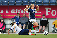 Fiona Brown (#20) of Scotland evades the sliding challenge from Elvira Urazaeva (#8) of Belarus during the FIFA Women's World Cup UEFA Qualifier match between Scotland Women and Belarus Women at Falkirk Stadium, Falkirk, Scotland on 7 June 2018. Picture by Craig Doyle.