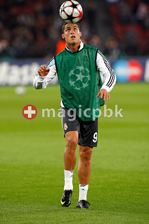 Real Madrid forward Cristiano Ronaldo juggles with a ball during his warm-up prior to the UEFA Champions League Group C soccer match between Switzerland's FC Zurich and Spain's Real Madrid at the Letzigrund Stadium in Zurich, Switzerland, Tuesday, Sept. 15, 2009. (Photo by Patrick B. Kraemer / MAGICPBK)