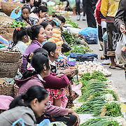 A row of vendors along one of the alleys at the morning market in Luang Prabang, Laos.
