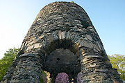 The Old Stone Mill tower. The orgin of the tower is disputed but it appears to predated the most european settlement and may be of Viking or early Portuguese explorer orgin. For a time it was owned by Benedict Arnold. - Newport, RI