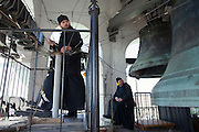 Moscow, Russia, 24/04/2011..Orthodox Easter bell ringing concert in the bell tower of Danilovsky Monastery, the oldest monastery in Moscow. During the concert parishioners and visitors are invited to play the bells with the assistance of the monks.