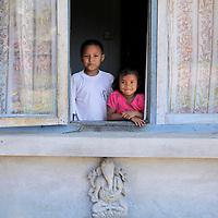 Asia, Nepal, Kathmandu. Kids in window.