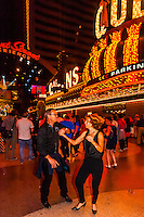 A couple dancing, Fremont Street Experience, Downtown Las Vegas, Nevada USA.
