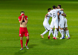 WREXHAM, WALES - Thursday, September 17, 2020: Connah's Quay Nomads' Kris Owens looks dejected as FC Dinamo Tiblisi players celebrate their 1-0 win thanks to an injury time penalty during the UEFA Europa League Second Qualifying Round match between Connah's Quay Nomads FC and FC Dinamo Tbilisi at the Racecourse Ground. Dinamo Tiblisi won 1-0. (Pic by David Rawcliffe/Propaganda)