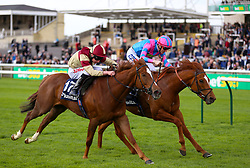 Examiner ridden by jockey Fran Berry (right) beats Red Tea ridden by jockey Luke Morris in the Plusvital Energene-Q10 Handicap during day one of The Bet365 Craven Meeting at Newmarket Racecourse, Newmarket.
