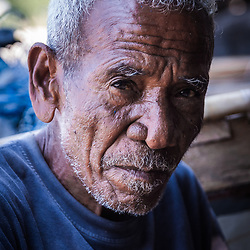 Retired Lamafa, Albertus Oka Sulaona, 69 years old – now mostly chilling by the sea. Smoking a self rolled tobacco cigarette with palm leaves