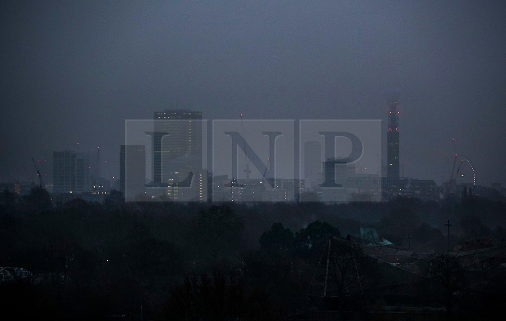 © Licensed to London News Pictures. 22/01/2020. London, UK. Seen from Primerose Hill central London's skyline is swathed in cloud as the sub zero temperatures come to an end. Photo credit: Peter Macdiarmid/LNP