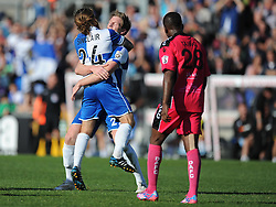 Bristol Rovers' Stuart Sinclair celebrates with Bristol Rovers' Adam Cunnington - Photo mandatory by-line: Alex James/JMP - Mobile: 07966 386802 - 04/10/2014 - SPORT - Football - Bristol - Stoke Gifford Stadium - Bristol Academy Womens v Notts County Ladies - Womens Super League