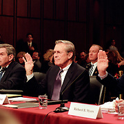 From left: Paul Wolfowitz, Deputy Secretary of Defense; Donald Rumsfeld, Secretary of Defense; General Richard Myers, Chairman of the Joint Chiefs of Staff, being sword in beforing testifying at the 9/11 Commission's Public Hearing Number 8 on Tuesday, 23 March 2004.