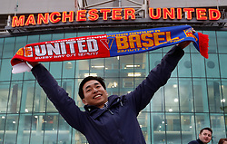 A fan poses with with a half and half scarf during the UEFA Champions League, Group A match at Old Trafford, Manchester.