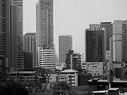"""14 JANUARY 2019 - BANGKOK, THAILAND:       Air pollution obscures the skyline in central Bangkok looking down Sukhumvit Road. Bangkok has been blanketed by heavily polluted air for almost a week. Monday morning, the AQI (Air Quality Index) for Bangkok  was 182, higher than New Delhi, Jakarta, or Beijing. The Saphan Kwai neighborhood of Bangkok recorded an AQI of 370 and the Lat Yao neighborhood recorded an AQI of 403. An AQI above 50 is considered unsafe. Public health officials have warned people to avoid """"unnecessary"""" outdoor activities and wear breathing masks to filter out the dust.      PHOTO BY JACK KURTZ"""