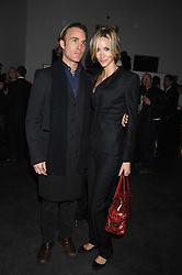 DAMIEN RAYNE and LISA BUTCHER at a private view of Octagan a showcase of work of photographer Kevin Lynch featuring the stars of the Ultimate Fighter Championship held at Hamiltons gallery, Mayfair, London on 17th January 2008.<br />