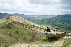 A Cyclist takes time out to adire the view from the top of Back Tor looking along the Great Ridge towards Mam Tor near Castleton in the Hope Valley <br /> <br />  19 April  2015<br />  Image © Paul David Drabble <br />  www.pauldaviddrabble.co.uk