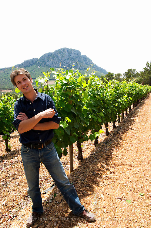 Yves Orliac, son of Jean and Marie-Therese Orliac. Domaine de l'Hortus. The Pic St Loup mountain top peak. Pic St Loup. Languedoc. Mourvedre vines facing south. Owner winemaker. France. Europe.