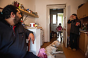 """Mario Bihari at home in Prague Zizkov with his family and guiding dog """"Harley"""". Mario is a well known blind Roma musician originally from Slovakia living since he finished his studies in Prague, Czech Republic. Beside being a very talented multi-instrumentalist working as a professional musician he is also experimenting with photography as a another way to express himself."""