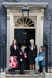 © Licensed to London News Pictures. 25/010/2018. London, UK. Prime Minister Theresa May meets fundraisers Claire Rowcliffe, Director of Fundraising at The Royal British Legion, Barbara Windsor (93) and Poppy Railton (9) for the Royal British Legion and purchase a poppy to launch the National Poppy Appeal 2018 outside 10 Downing Street. Photo credit: Dinendra Haria/LNP