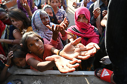 April 12, 2020, Prayagraj, Uttar Pradesh, India: People queue for free food at a community kitchen on the outskirts of Allahabad during a government-imposed nationwide lockdown as a preventive measure against the COVID-19 coronavirus. (Credit Image: © Prabhat Kumar Verma/ZUMA Wire)