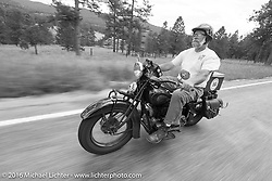 Dave Holzerland riding his 1935 Indian Four during Stage 9 (249 miles) of the Motorcycle Cannonball Cross-Country Endurance Run, which on this day ran from Burlington to Golden, CO., USA. Sunday, September 14, 2014.  Photography ©2014 Michael Lichter.