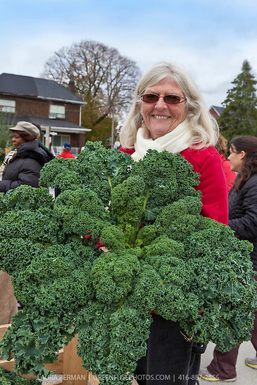 Colette Murphy with an armfull of kale at Wychwood farmers Market