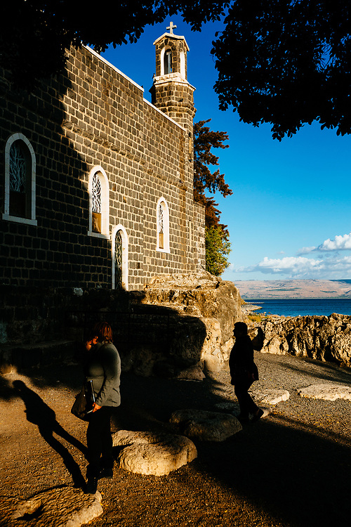 Christian worshippers are seen outside The Church of the Primacy of St. Peter, built over a rock traditionally thought to be where Jesus shared a meal with his disciples after the resurrection, on the northern shore of the Sea of Galilee, northern Israel, on December 7, 2017.