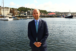 Ben macpherson minister for migration at new pontoons oban bay  on the ministers visit to      Argyll and Bute  picture kevin mcglynn