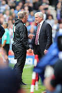 Stoke City Manager Mark Hughes is sent off to watch the remainder of the game from the stands by Referee Anthony Taylor and his fourth official J Moss. Premier league match, Stoke City v Tottenham Hotspur at the Bet365 Stadium in Stoke on Trent, Staffs on Saturday 10th September 2016.<br /> pic by Chris Stading, Andrew Orchard sports photography.