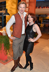 Actress DAISY LEWIS and HENRY CONWAY at the launch of A Season In France hosted by Jasper Conran at The Conran Shop, 81 Fulham Road, London on 1st May 2014.
