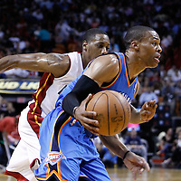 16 March 2011: Oklahoma City Thunder point guard Russell Westbrook (0) drives past Miami Heat point guard Mario Chalmers (15) during the Oklahoma City Thunder 96-85 victory over the Miami Heat at the AmericanAirlines Arena, Miami, Florida, USA.